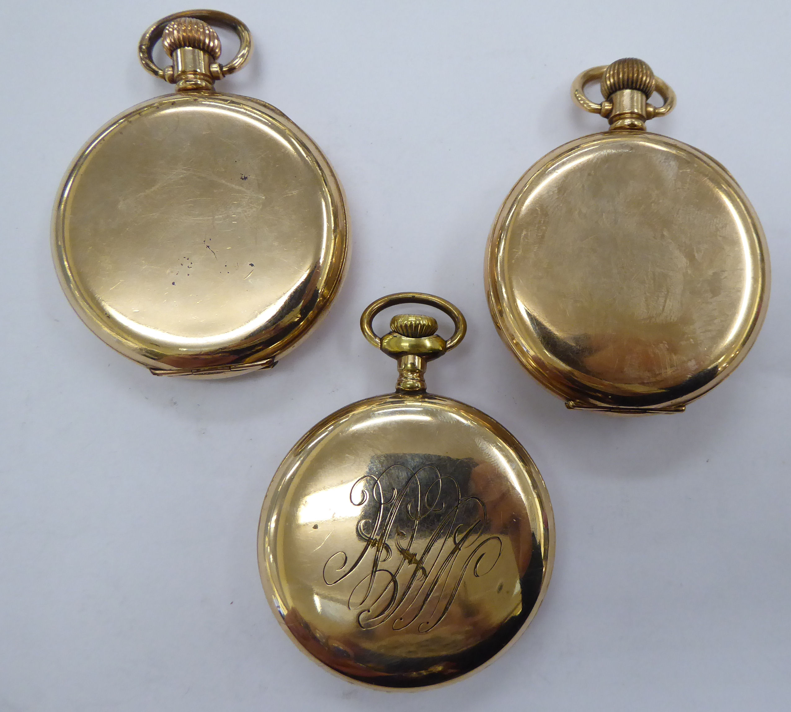 Lot 51 - Three late 19th/early 20thC gold plated pocket watches with enamel Roman and Arabic dials