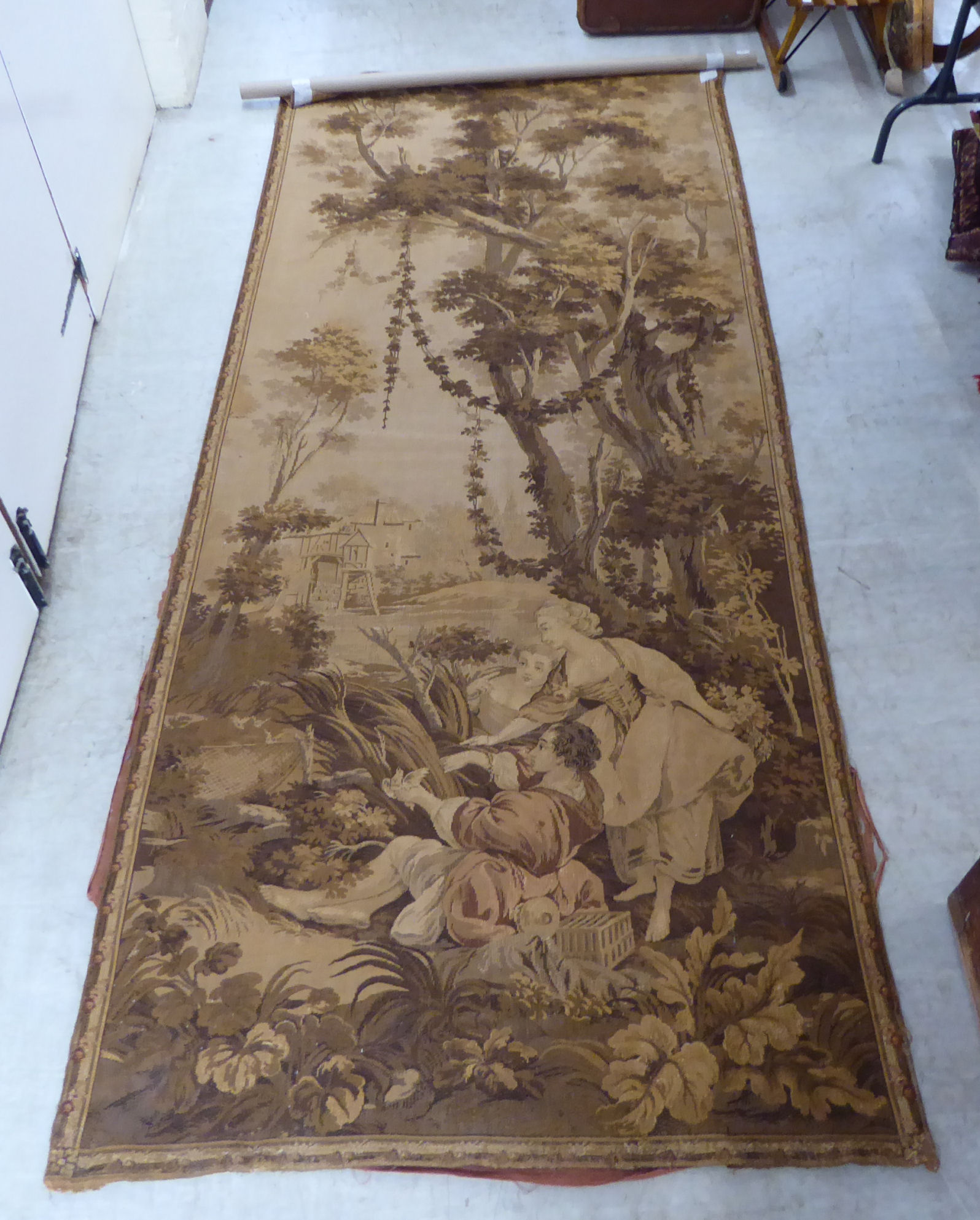 Lot 23 - A 20thC Flemish inspired tapestry wall hanging with figures in a garden 46'' x 112'' BSR