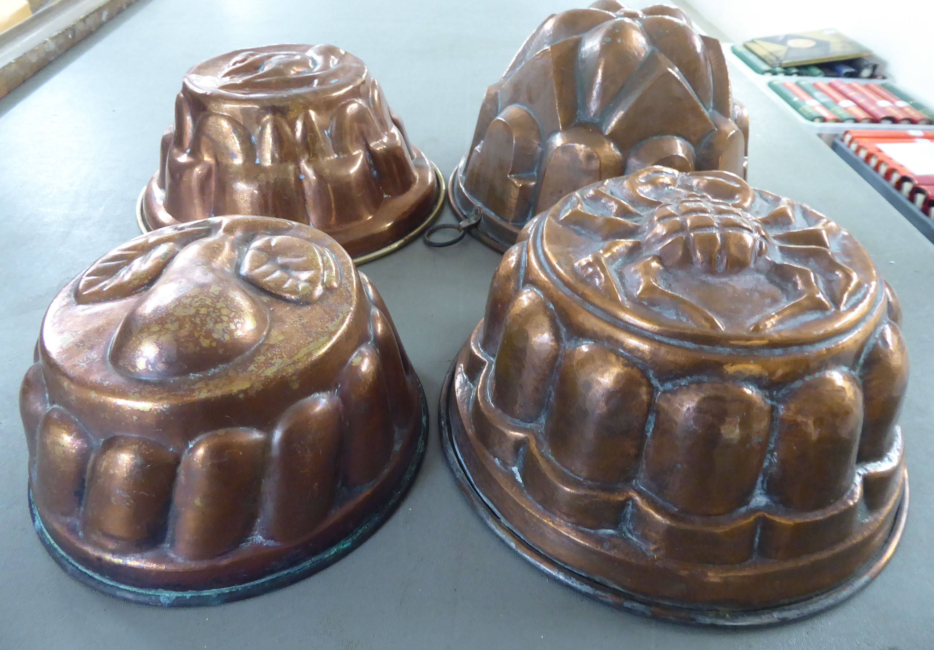 Lot 6 - Four Victorian style copper jelly moulds of domed form,