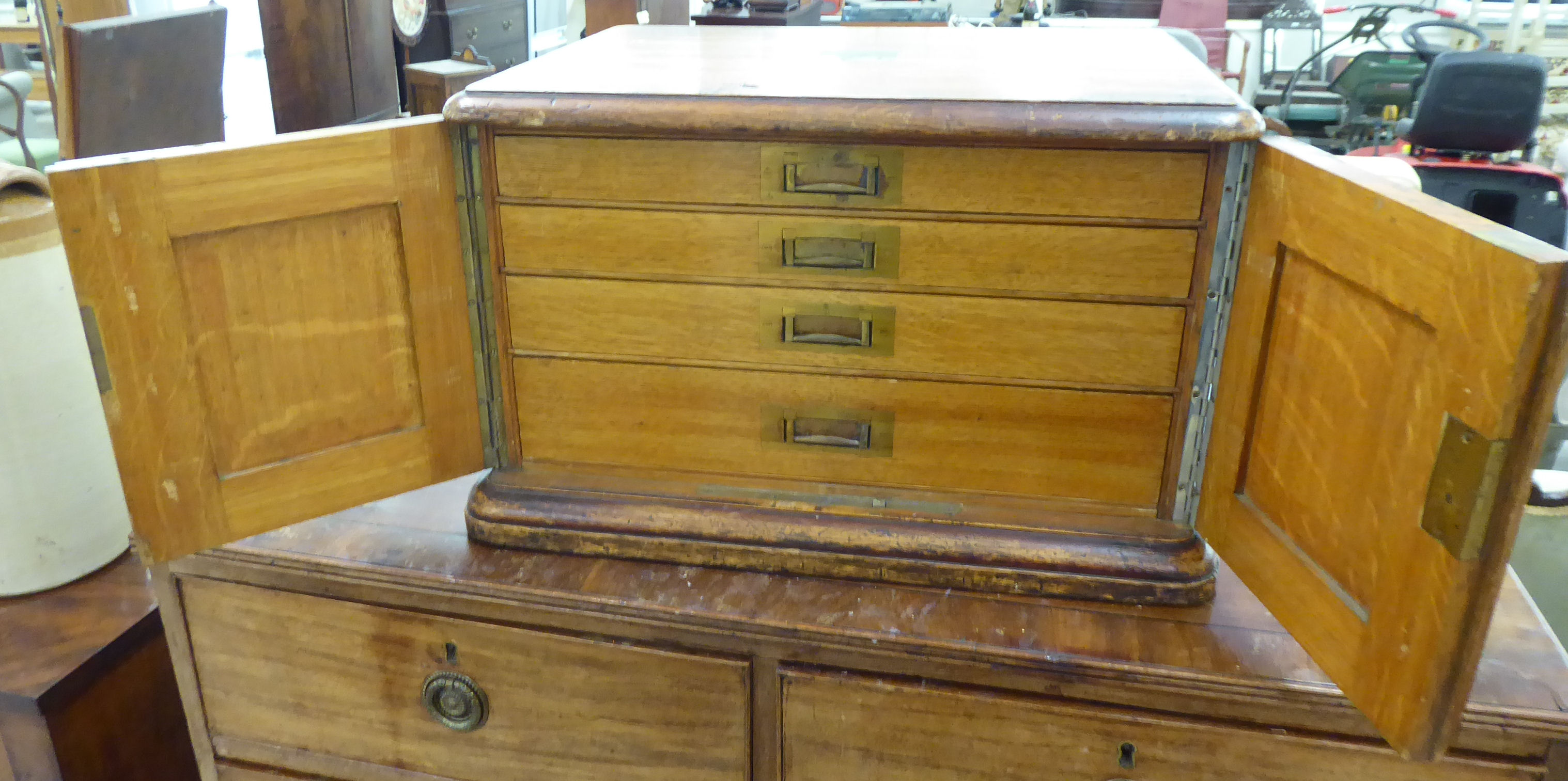 Lot 41 - A 1920s oak canteen chest (only) with a pair of locked doors,