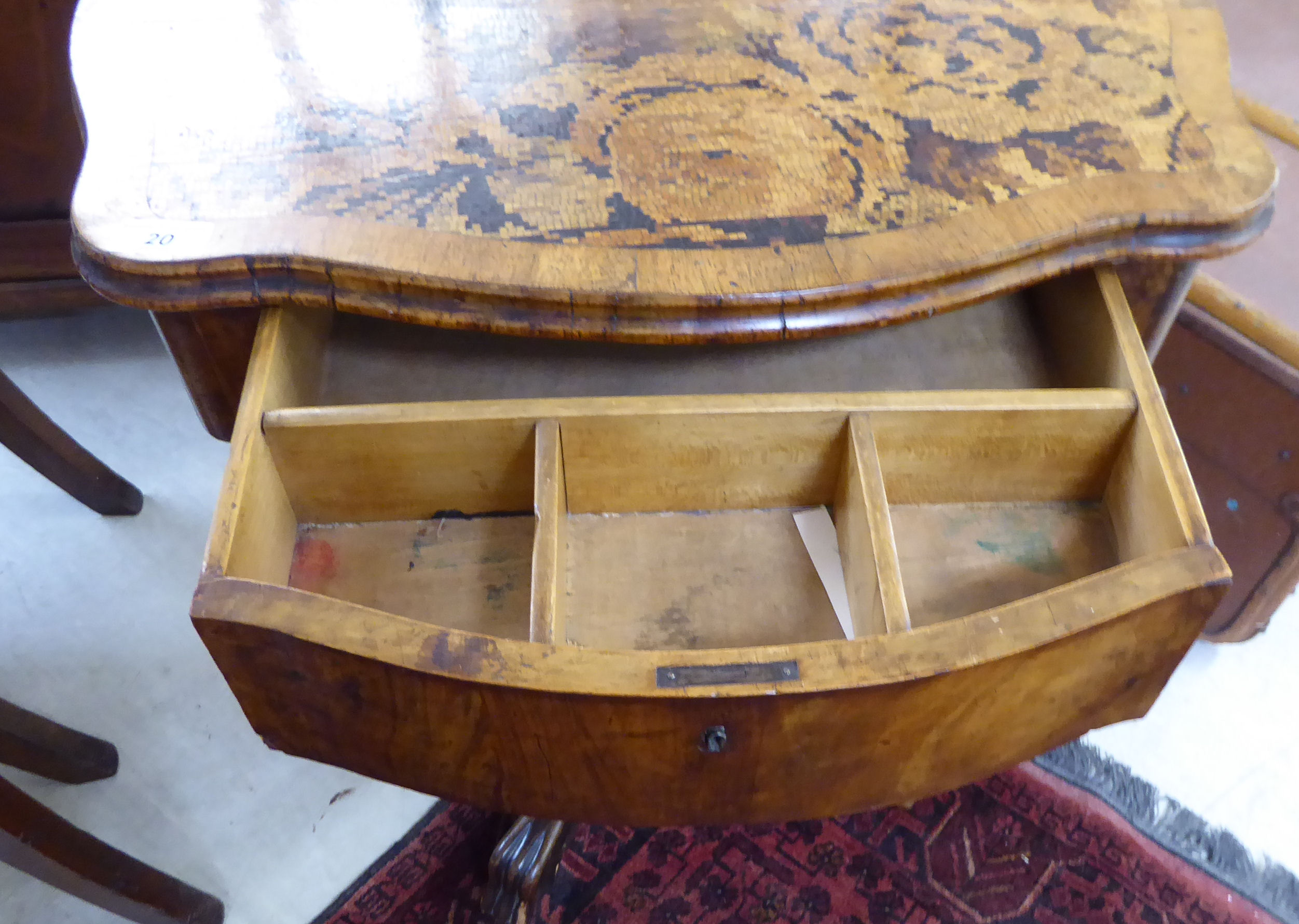 Lot 20 - A late 19thC work table, the serpentine outlined crossbanded mahogany top with a frieze drawer,