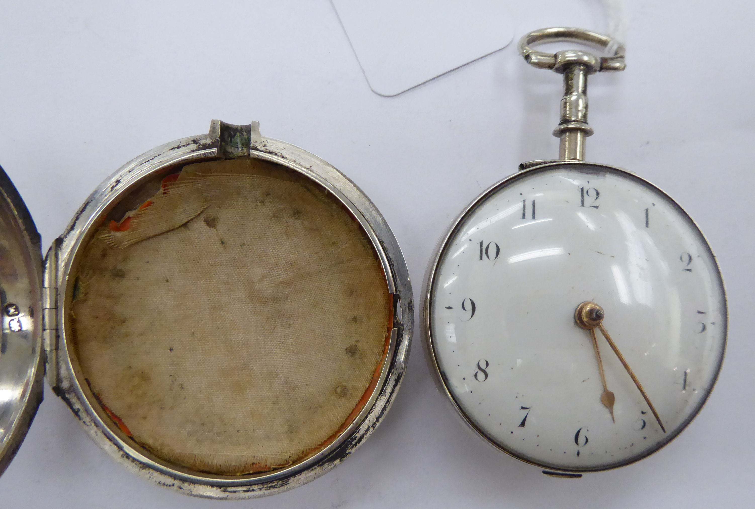 Lot 21 - A George III silver pair cased watch with an enamelled Arabic dial Richard Healey No.
