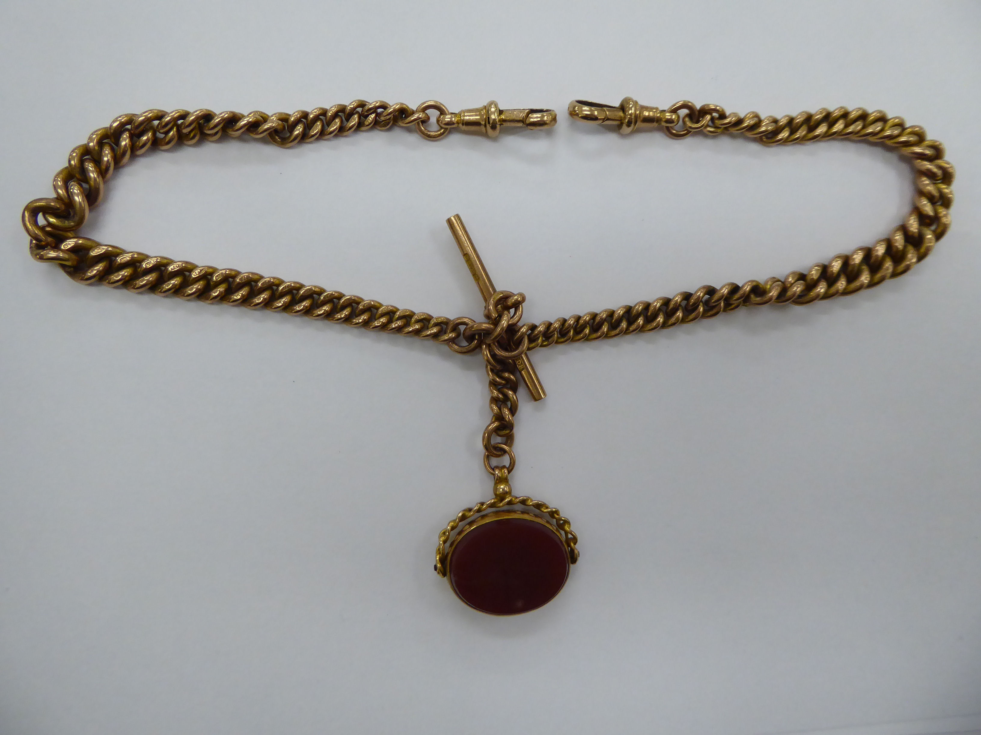 Lot 28 - A 9ct gold fob watch double chain with a T-bar and swivel bloodstone set pendant 11