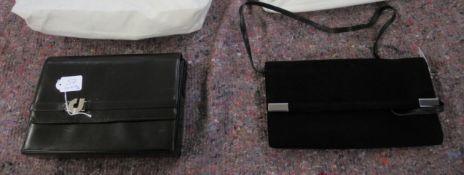 A Charles Jourdan black suede finished clutch bag;