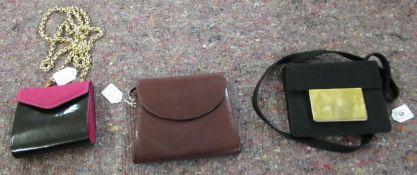 A Bruno Magli red leather clutch bag; a Louis Feraud black patent purse;