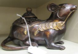 An Oriental cast and patinated and part gilded censer and cover, fashioned as a seated rodent,