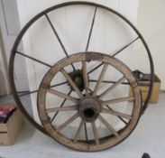 Two 19thC cast iron framed cartwheels 52'' & 39''dia BSR