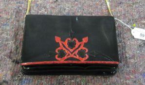 A Rene Caovilla black patent leather clutch bag with a gilt metal shoulder strap OS8