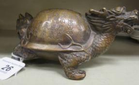 An Oriental cast bronze model,
