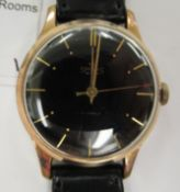 A 1950s Smiths gold plated and stainless steel cased wristwatch, the movement with sweeping seconds,