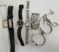 Ladies wristwatches: to include a stainless steel cased fossil bracelet watch with a baton dial
