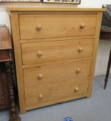 A modern Cotswold Oakley pine four drawer dressing chest, raised on bracket feet 39''h 33.