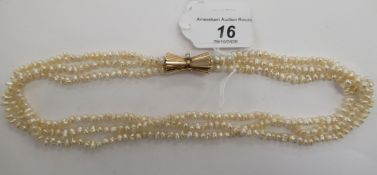 A triple row cultured pearl necklace,
