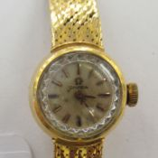 A lady's 18ct gold cased Omega wristwatch,