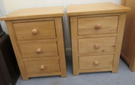 A pair of modern Cotswold Oakley pine three drawer bedside chests,