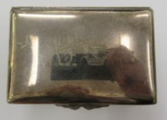 A silver snuff box of rectangular ogee form,