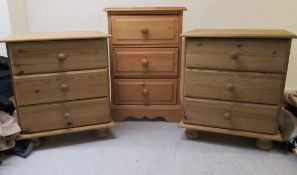 Three similar pine three drawer bedside chests, on plinths largest 23''h 15.
