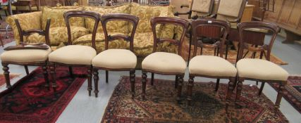 A set of six late Victorian mahogany framed, waisted spoonback dining chairs, the upholstered,