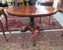 A late Victorian mahogany occasional table with an oval top,