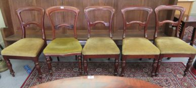 A set of four late Victorian mahogany framed dining chairs,