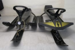 Two similar TIGA snow racer GT Sledges CA