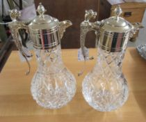 A pair of modern glass claret jugs with silver plated collars and handles CA