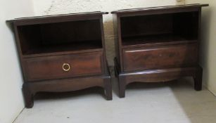 A pair of 20thC Stag mahogany bedside chests, each with an open shelf, over a long drawer,