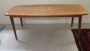 A 1970s teak coffee table,