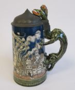 A 20thC Villeroy & Boch Mettlach pottery stein with a hinged pewter lid and dragon handle,
