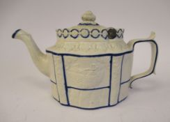 A late 18th/early 19thC Staffordshire naturally coloured biscuit porcelain and blue lined teapot of
