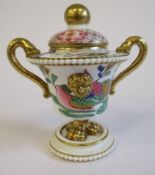 A 19thC porcelain gilded and painted, mask decorated,