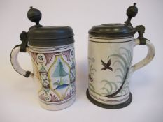 A late 18thC North European tin glazed earthenware cylindrical stein with a hinged pewter cover and