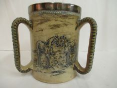 A Doulton Lambeth brown and blue glazed stoneware tyg, having straight sides,