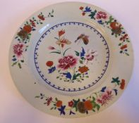 A late 18thC Chinese famille rose, broad rimmed porcelain plate, decorated with flora,