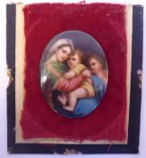 A 19thC painted oval porcelain plaque, featuring the Madonna and child with another 3.5'' x 2.