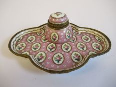 A 19thC Continental gilt metal mounted porcelain inkwell, on a matching, oval, lobed saucer,