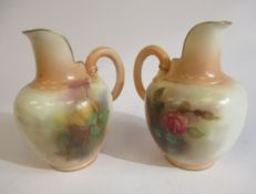 A pair of Royal Worcester gilded ivory glazed china flatback jugs, decorated with roses (No.