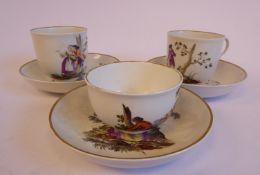 A matched pair of early 19thC Continental porcelain cups and saucers,