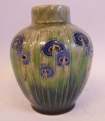 A Royal Doulton stoneware vase of baluster form, decorated in tubeline, tones of green,