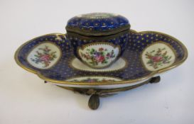A 19thC Continental gilt metal mounted porcelain inkstand, attached to a lobed, oval saucer,