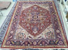 A Persian carpet, decorated with repeating geometric designs,
