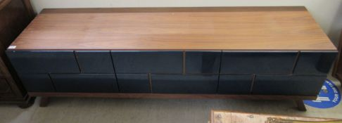 A modern teak finished entertainment unit with two drawers,