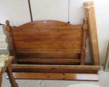 A pine framed bed with mattress the headboard 66''w BSR