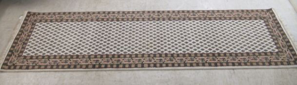 An Indian runner, decorated with small repeating trees,