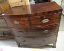 A Regency mahogany bow front dressing chest with two short/two graduated long drawers,