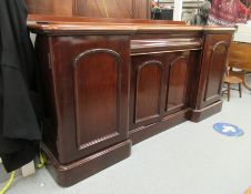 A mid Victorian mahogany chiffonier, the breakfront top, over three cupboard sections,