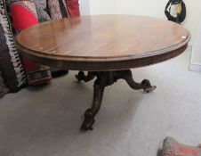 A William IV rosewood veneered centre table, the top raised on a bulbous,