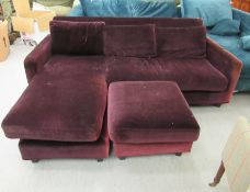A modern purple fabric upholstered two seater settee with a cushioned back,