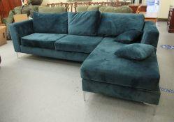 A modern blue fabric upholstered L-shaped settee with a cushioned back,