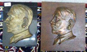 A gilded iron profile portrait plaque,